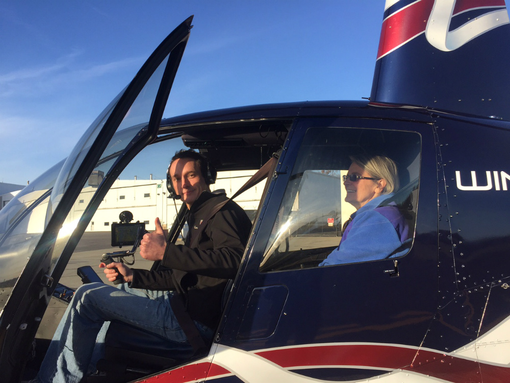 photo of Monroe flying a helicopter